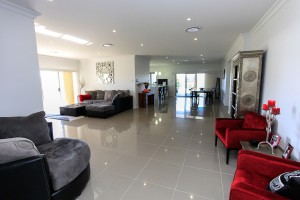 Open plan living custom home design Valley home builders
